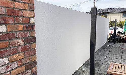 Block and Plaster Masonry Wall